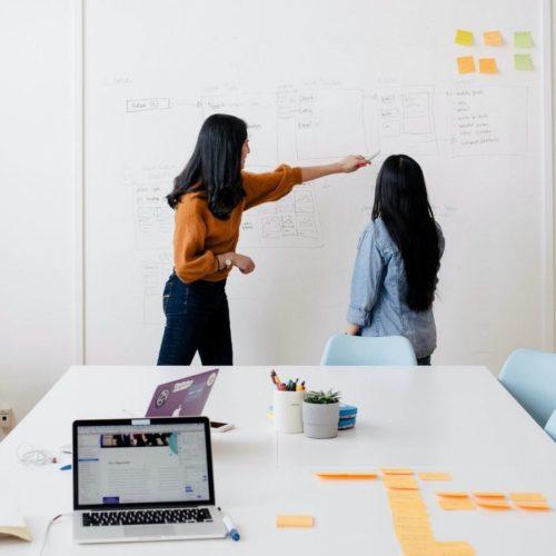 Customer Communications Management women discussing communications plan